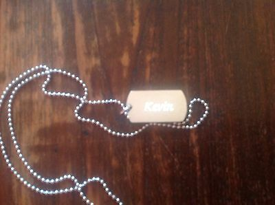 Silver colour necklase with name KEVIN in a black box