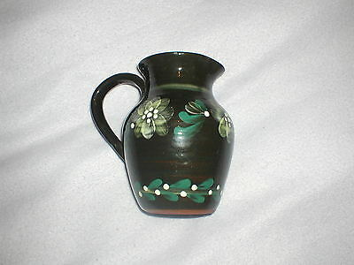 Black Pottery Jug With Flower Decoration - Isle of Wight - Haseley Manor