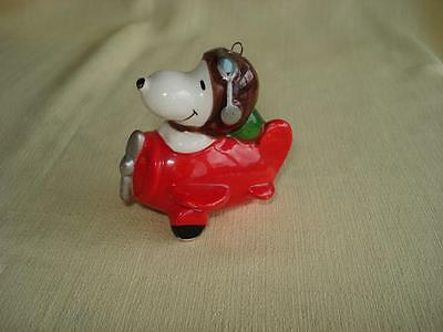 Vintage PEANUTS Christmas Ornament Ceramic Snoopy in Red Airplane