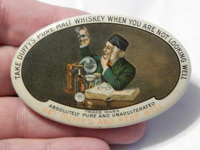 Celluloid Duffy's Malt Whiskey Advertising Mirror Token