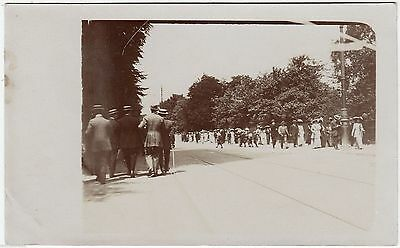 A BUSY UNLOCATED STREET - Tramlines etc - c1910s era Real Photo postcard