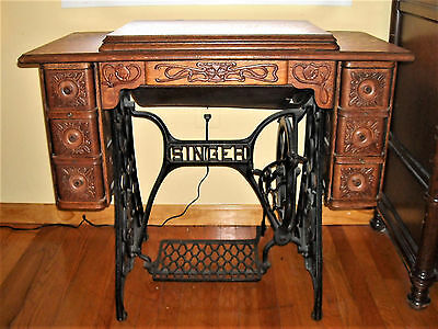 Singer treadle sewing machine cabinet.7 embossed drawers +key