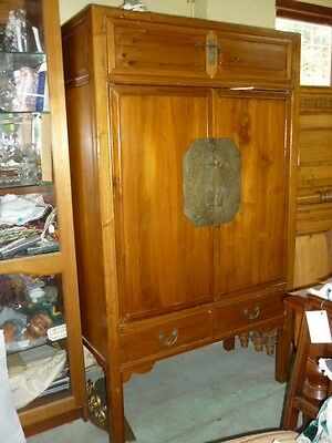 Mid 20th century Chinese cabinet or linen cupboard in good varnished condition