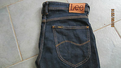 Vintage Lee Jeans with Special Stitching and Leather Patch on Back (Size 34)