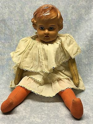 Antique doll Celluloid head, leather arms, body and fabric legs