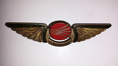Vintage Continental Airlines Plastic Gold & Red Wings Pin