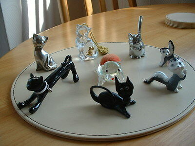 Selection of 8 collectable figures of cats.some glass & a couple silver colour