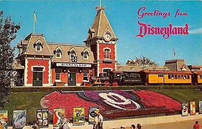 Greetings from Disneyland Postcard Entrance green train, floral mickey A-2