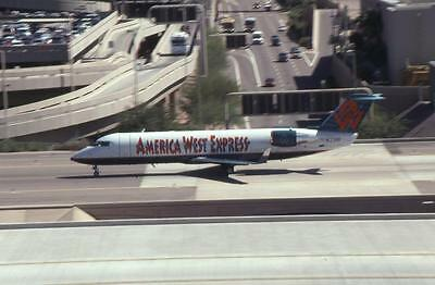 Original 35mm Aircraft Slide America West Canadair CRJ-200LR N77181 PHX 10/97