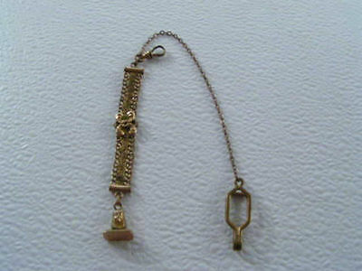 This is an unusual antique watch chain with an egyptian pendant.