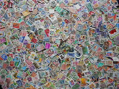 Bulk about 1200 Mixed world stamps off paper over 100 grams