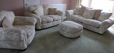 3 piece suite incl. footstool armchair, 3 & 2 seat sofas in cream fabric. Settee