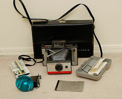 Vintage Polaroid Automatic Land Camera model 104 with Case and Accessories