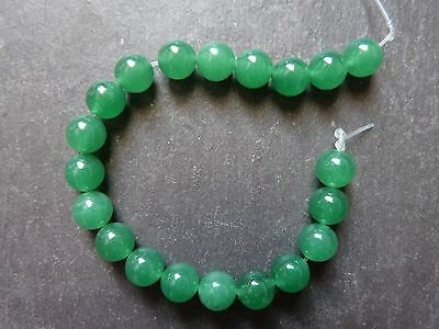 Natural Canada Jade ~ smooth rounds, 8.5mm ~ strong green ~ 10 beads