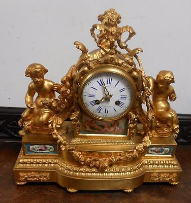 very nice ormolu and porcelain panneled french mantel clock by raingo freres