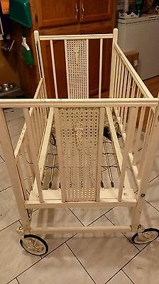 antique wooden baby crib with metal swivel casters