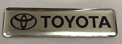 2x TOYOTA Logo 3D Mirror Domed Stickers. Size 65x17mm.