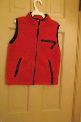 Boys T. K. S. Basic vest. Size 5/6. Red with black zippers. Soft, fleecy