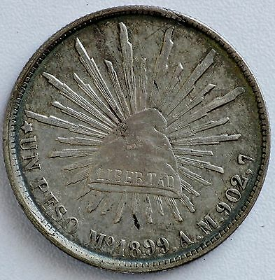 1899 Mo AM Mexico Silver Un One Peso Radiant Cap Silver Dollar Coin (LV#NN)