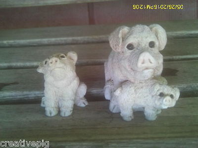 Two Figurines of Three Little White Pigs