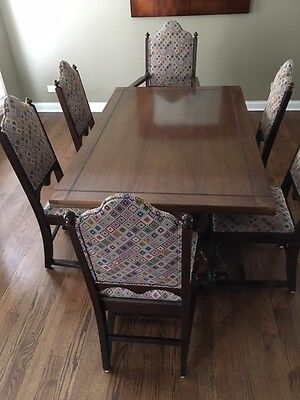 Dining table with built in expansion and six chairs circa 1925