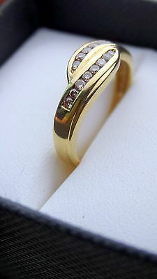 Twist style wedding ring with yellow Gold and Diamonds