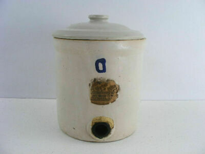 This is an antique crock water filter made by the Nappanee Water Filter Company.