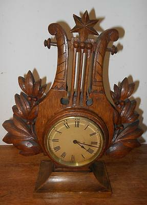 carved oak lyre shaped 8 day timepiece mantle clock c1900s