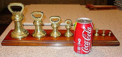 Unusual antique 9 brass bell scale weights w wood stand-----15392