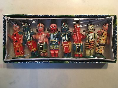 A small boxed set of 8 carved and hand painted Hindu gods.