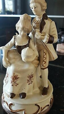 Vintage music playing and rotates porcelain  statue