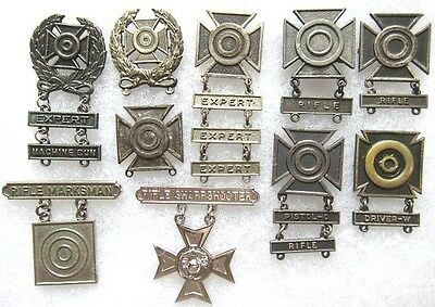 Lot of 10 WWII+ US Army & Marine Corps skill badges; 4 w/sterling marked parts