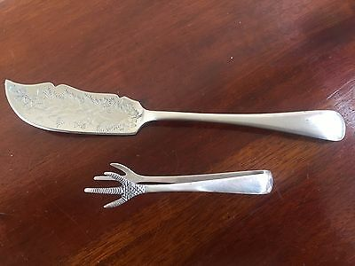 Silver Sugar Tongs And One Other Spoon