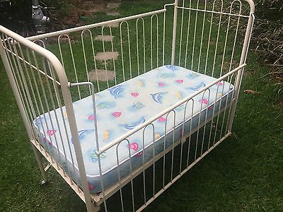 White metal cot with mattress