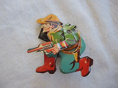 Toy litho clicker noisemaker Cowboy with moving arm Vintage very RARE item