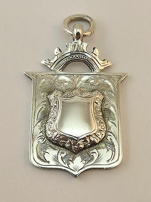 c1912, ANTIQUE SOLID SILVER WATCH CHAIN FOB SHIELD AND CROWN MEDAL PENDANT