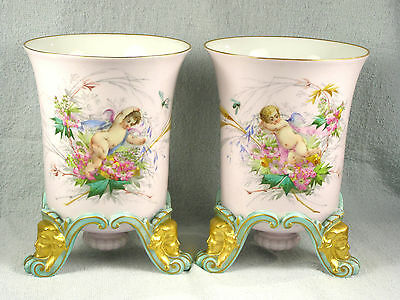 PAIR Hand Painted Portrait Footed Urn Vases with Cherubs & Flowers