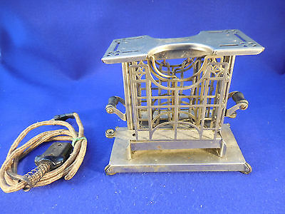 century old universal kitchen bread toaster with cord really good condition