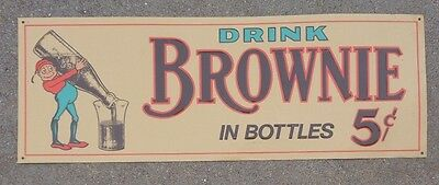 old embossed tin litho sign advertising Brownie Soda