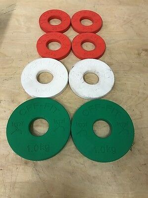 A SET of 8 CFF - FIT CALIBRATED WEIGHT PLATES USED