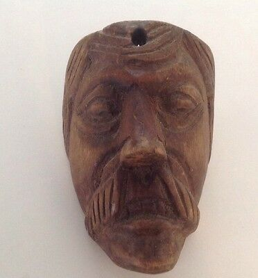 Old Wooden Carving Of A Gentleman With A Beard.