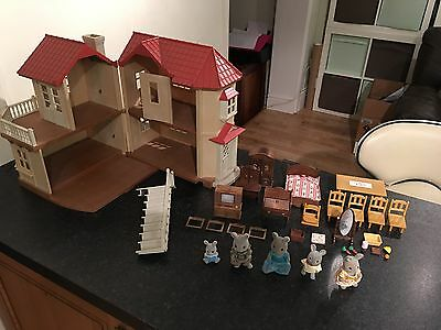Sylvanian Families House With A Bundle Of Figures Furniture And Accessories