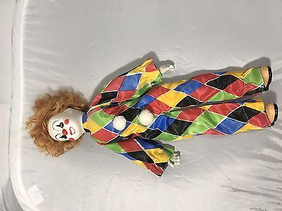 Vintage Clown doll with porcelain hands/feet/head with music box