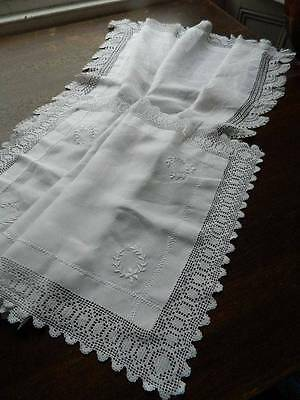 Two vintage white Irish linen table runners with lace edges.
