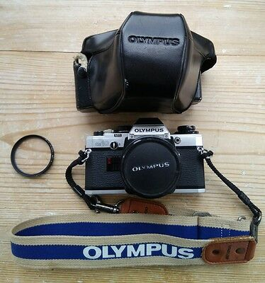 how to use an olympus om10 camera film