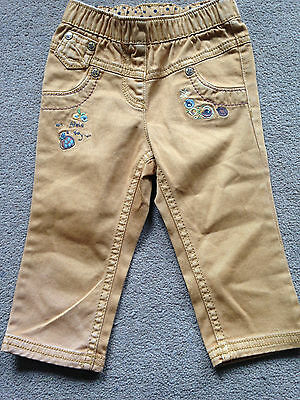 BNWT NEXT Girls Mustard Apple a Day Jeggings Skinny Jeans 6-9 Months