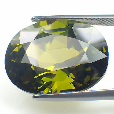A PAIR OF 6x4mm OVAL-FACET OLIVE-GREEN CUBIC ZIRCONIA GEMSTONES