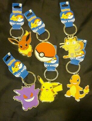 6 POKEMON Pikachu,Meowth,Evee, Pokeball,Charmander  Metal Keychain Collection