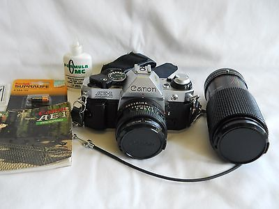 Canon AE-1 Program 35mm camera w/50mm 1:1.8 and 80-200mm telephoto lens + acc