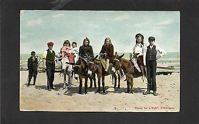 Old postcard of  donkeys on beach Withernsea 1910.